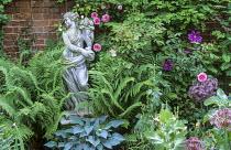 Stone statue, Rosa 'Blairii Number Two', ferns, hosta, allium, clematis