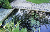 Formal reflective pond, tile edging by Delphina Bottacini, pebble mosaic by Michael Gough, Aponogeton distachyos, Water hawthorn