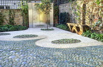 Contemporary urban courtyard, pebble mosaic, wooden bench, Echeveria elegans, wall water feature