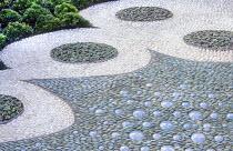 Contemporary urban courtyard, pebble mosaic, ceramic tiles, Echeveria elegans