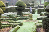 Yew topiary in frost, box edged parterre, putto on plinth