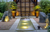 Zen-inspired Japanese garden, bonsai, bench, bamboo screen, formal pool