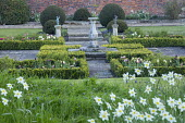 Stone sundial in formal garden, clipped box parterre, low hedges