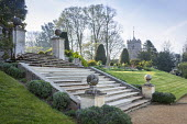 Terraced lawn, stone steps, stone piers, Taxus baccata, view to church