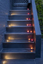 Candles on black steps