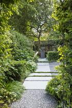 Stone path through across gravel terrace, Thymus serpyllum rills, view to urn on plinth, clipped yew cubes, Hakonechloa macra, Hydrangea arborescens 'Annabelle', Rodgersia aesculifolia