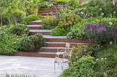 Chairs on decking, Geranium 'Rozanne', Salvia nemorosa 'Caradonna', Pinus mugo, Hakonechloa macra, Persicaria bistorta 'Superba', Euphorbia x martini, Cor-Ten steel edged gravel steps