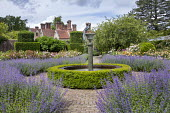 Circular water fountain in rose garden, Nepeta x faassenii, low box hedge edging, view to house