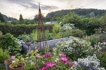 Raised kitchen garden, rose garden, metal obelisk