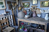 Interior of garden shed, tools, labels,