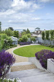 Stone steps, curving gravel path around lawn, salvia, table and chairs