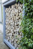 Cut log storage cupboard
