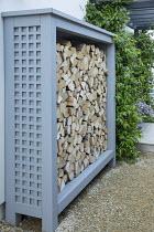 Painted cut log storage cupboard