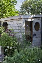 Wooden playhouse, Verbena bonariensis, rosemary, alliums