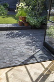 View from inside to black permeable paving outside