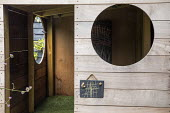 Wooden playhouse with astroturf carpet