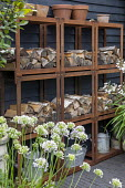 Metal wood storage shelving system, alliums, watering can