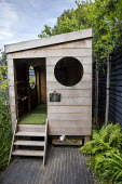 Wooden playhouse, black paving