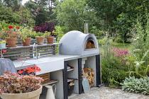 Outdoor kitchen, pizza oven, sink, worktop, Cynara cardunculus, Penstemon 'Andenken an Friedrich Hahn', Stachys byzantina 'Big Ears'