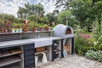 Outdoor kitchen, pizza oven, sink, worktop, Cynara cardunculus, Penstemon 'Andenken an Friedrich Hahn'
