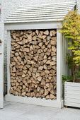 Cut log timber store by house