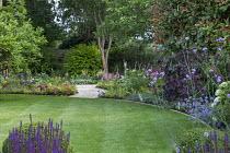 Circular lawn, gravel path, Dryopteris erythrosora, hostas, astilbe, geranium, pulmonaria, verbena