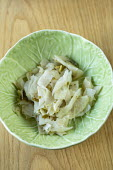 Kohl rabi with celery seed and lovage in bowl