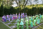 Painted papier-mâché chess set in yew hedge enclosure