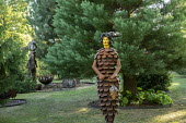 Metal pine cone woman, metal gates