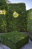 Diamond-shaped box topiary, clipped window in hornbeam hedge, borrowed view of vineyard, garden 'room'
