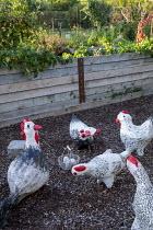 Painted papier-mâché hen sculptures