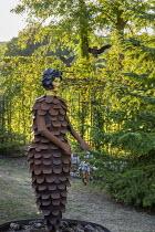 Metal pine cone woman, metal arbour