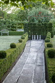 Bowling allée enclosed by topiarised box hedges, yew topiary bowling pins
