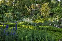 Clipped box hedges, rose arch, Aruncus dioicus