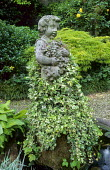Ivy covered stone statue, acer
