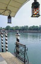 Mooring posts, landing stage, view accross lagoon to gardens of Isola di S. Giorgio Maggiore, Hotel Cipriani, Venice