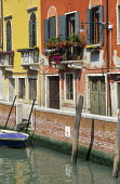 Colourful painted houses by canal in Venice, balcony