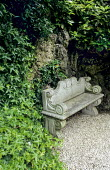 Classical stone bench in shady corner