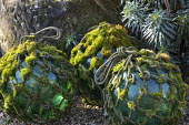 Moss-covered rope around glass ball ornaments