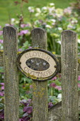 Clover Cottage sign on wooden picket gate